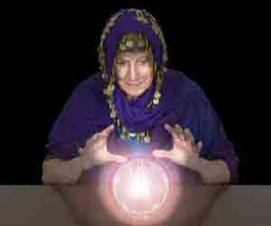 woman looking into a crystal ball